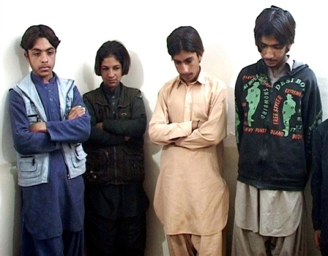 14-year-old Sabir, far right, and other boys are paraded in front of the media by police in the Pakistani city of Quetta after they were arrested on suspicion of taking part in attempted bomb attacks