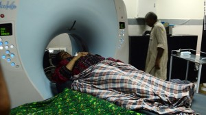 An earthquake survivor undergoes tests at a hospital in Karachi